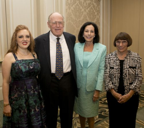John and Alexandra Nichols stand with two award honorees