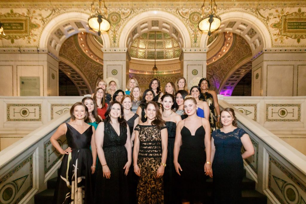 The Junior League of Chicago's Annual Gala Committee members in the Chicago Cultural Center's Preston Bradley Hall.