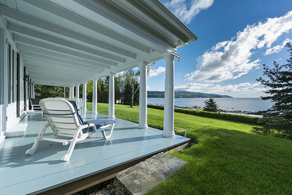The porch and the view from the home the architect built for Edith, photographed by Rene Bouchard.