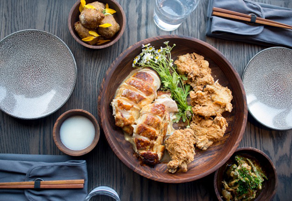Cool tones and warm woods serve as an attractive and inviting background for the popular Deconstructed Chicken at Roister.