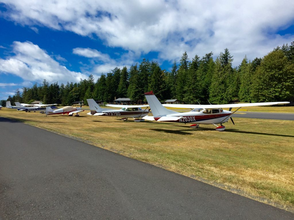 A lineup of seaplanes.