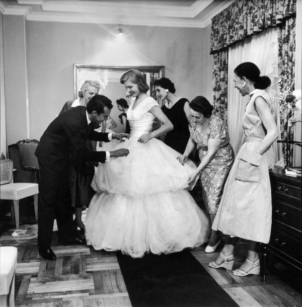 Beatrice Lodge, being fitted in her debutante gown by Oscar de la Renta, in 1956.
