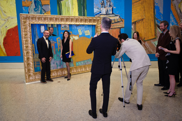 Part of the evening's entertainment was a photo-op in front of a larger-than-life reproduction of Van Gogh's Bedroom.