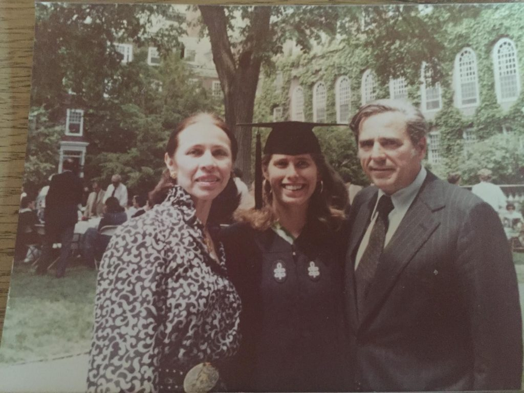 Elise with her parents at her graduation from Harvard.