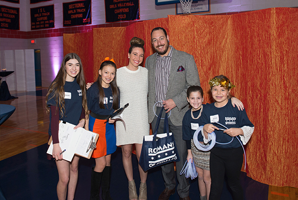 Husband and wife and both Latin Graduatesl, Gigi Stender-Schwertfeger and Andrew Schwerfeger with student raffle sellers.