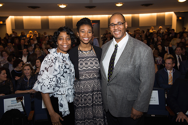 Latin alumni speaker Jasmine Arrington, class of '11, with her parents Keisha and Darryl Arrington.
