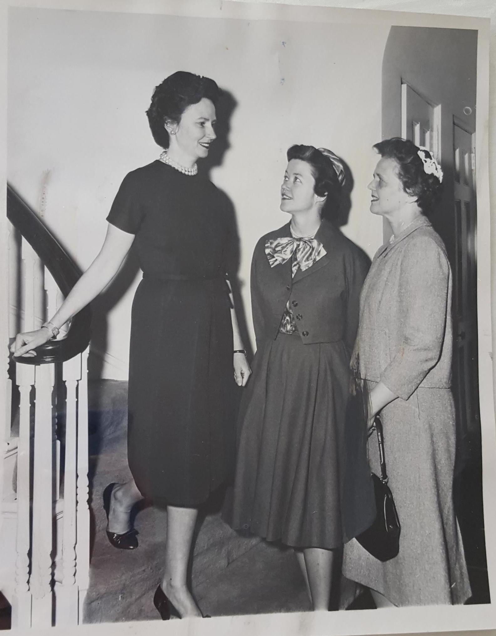 This photograph from 1961 has this notation on the back: Mrs. George B. Young (left) greets Mrs. Mark Willing Jr. for a luncheon and invitation-addressing meeting at Mrs. Young's apartment Wednesday. The women were addressing bids for the Chicago Commons informal dinner dance May 5 at the Germania Club.