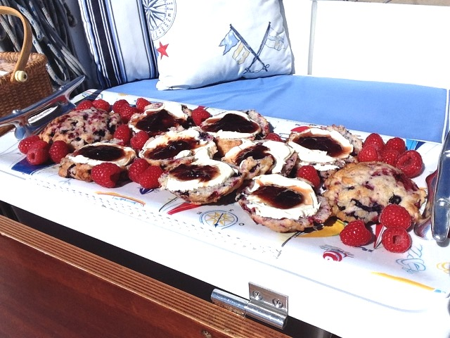Catering, including these fresh berry scones with clotted cream and strawberry preserves, was provided by Catering Chocolate.