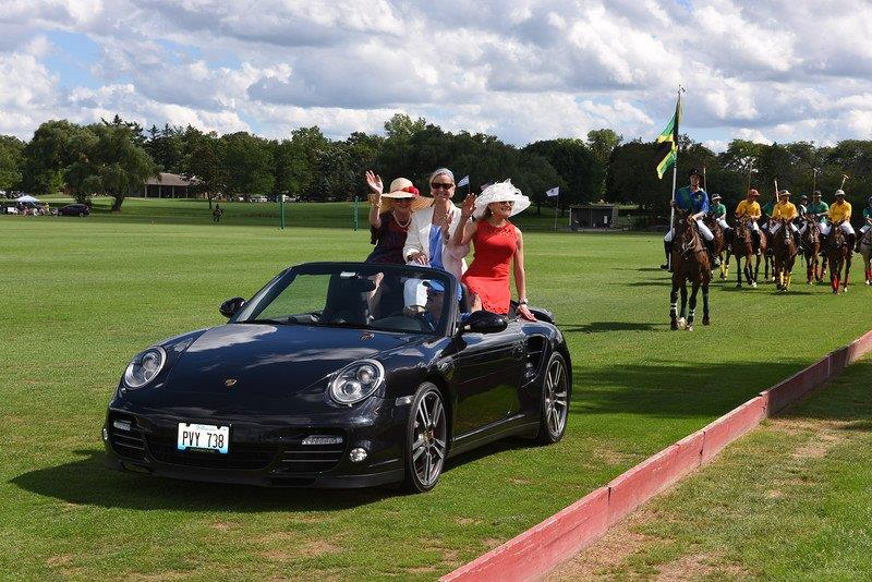 Event Co-Chairs lead the polo teams to the open ceremonies. Photo by Jennifer Girard.