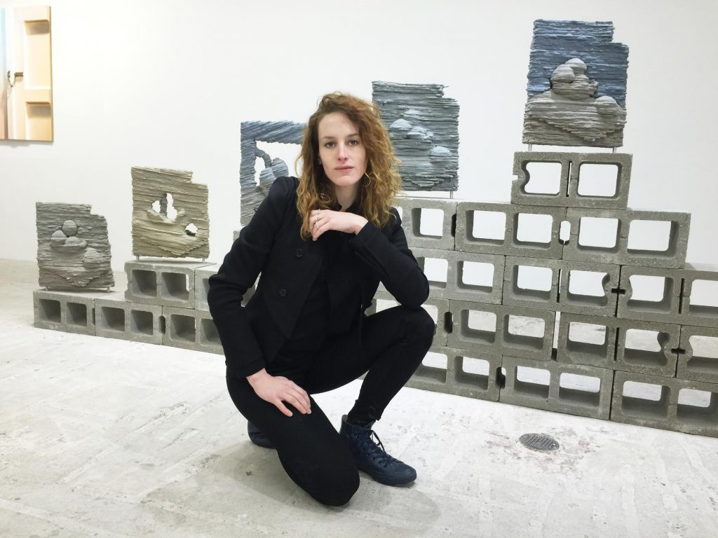 Chicago-born artist, Dwyer Kilcollin, in front of her work at New York's Lyles & King gallery, for the group show titled Low.