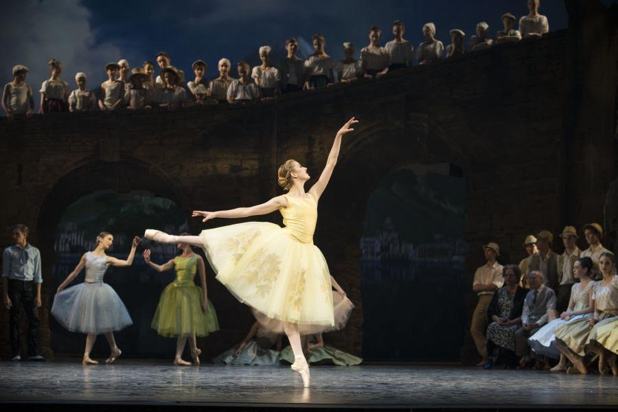 """Caroline dances the """"Napoli"""" Pas de Six, surrounded by the many dancers and cast members of the Royal Danish Ballet."""
