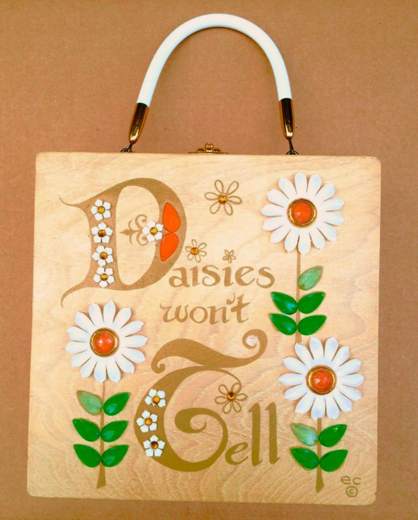 Enid Collins', Collins of Texas 1960s 'Daisies Won't Tell' box bag.