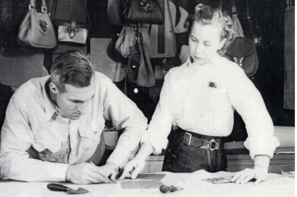 Frederic and Enid Collins making leather handbags.