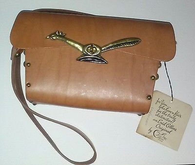 A rare example of one of the early leather handbags made by Collins of Texas.