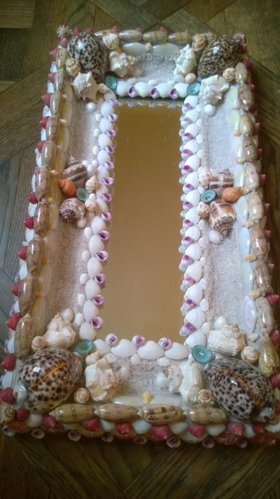 """""""I think this is one of my best. Among the shells I used were olives, cay cays, telling, tiny tulips, and nutmeg and bubble shells. I have worked with about 35 different shells, I believe."""""""