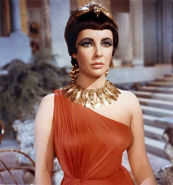 Elizabeth Taylor wearing Joseff of Hollywood jewelry in the 1963 movie, Cleopatra.