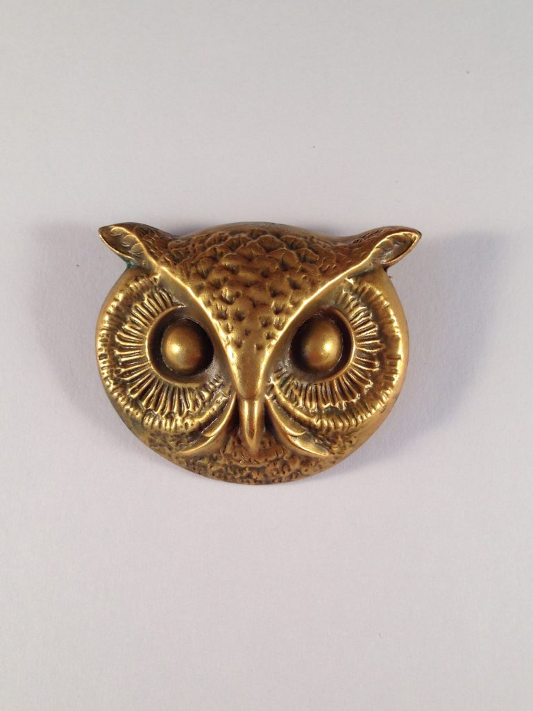 Front and back views of a Joseff owl brooch signed 'Joseff' on the back in a round plaque. From thecollection of Ladybug Vintage.