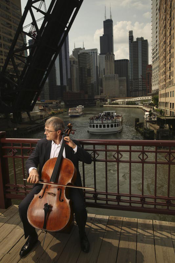CSO cellist John Sharp playing on one of Chicago's picturesque bridges.