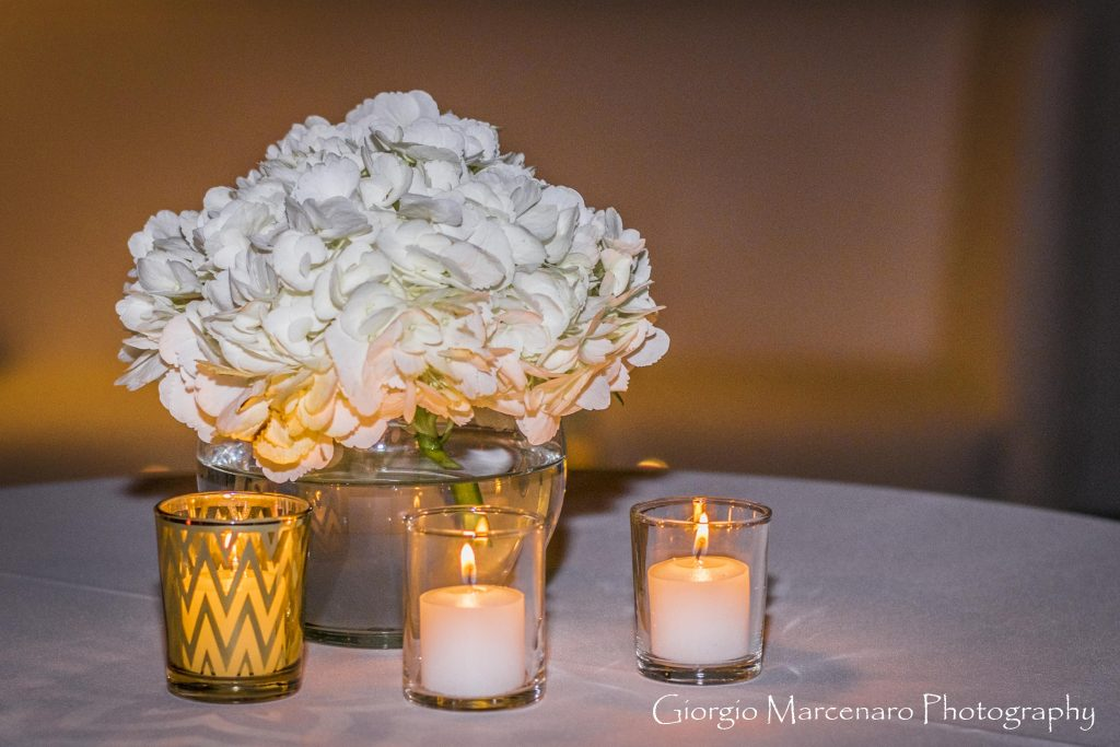 The pale color palette was given warmth by the glow of candles.