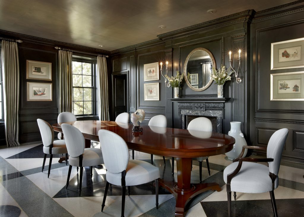 This dining room's paneling creates perfect spaces for art.