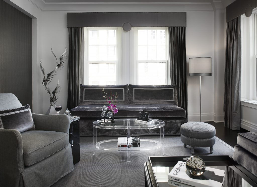 Shades of gray and silver, rendered in different finishes and fabrics, created a monochromatic, but never monotonous, look.