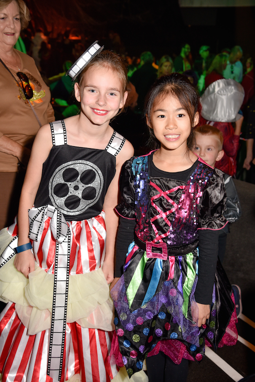 The winner of Best Overall Costume, The Queen of the Silver Screen (an appropriately film-themed costume), with a friend in another colorful look.