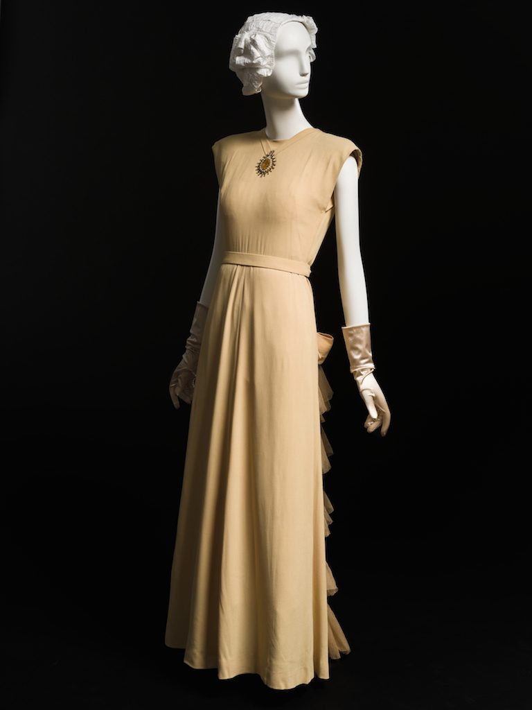 Apricot evening dress with bows and tulle bustle; evening dress, fall 1946. Gift of Mrs. A. Waston Armour, III; 1959.355.