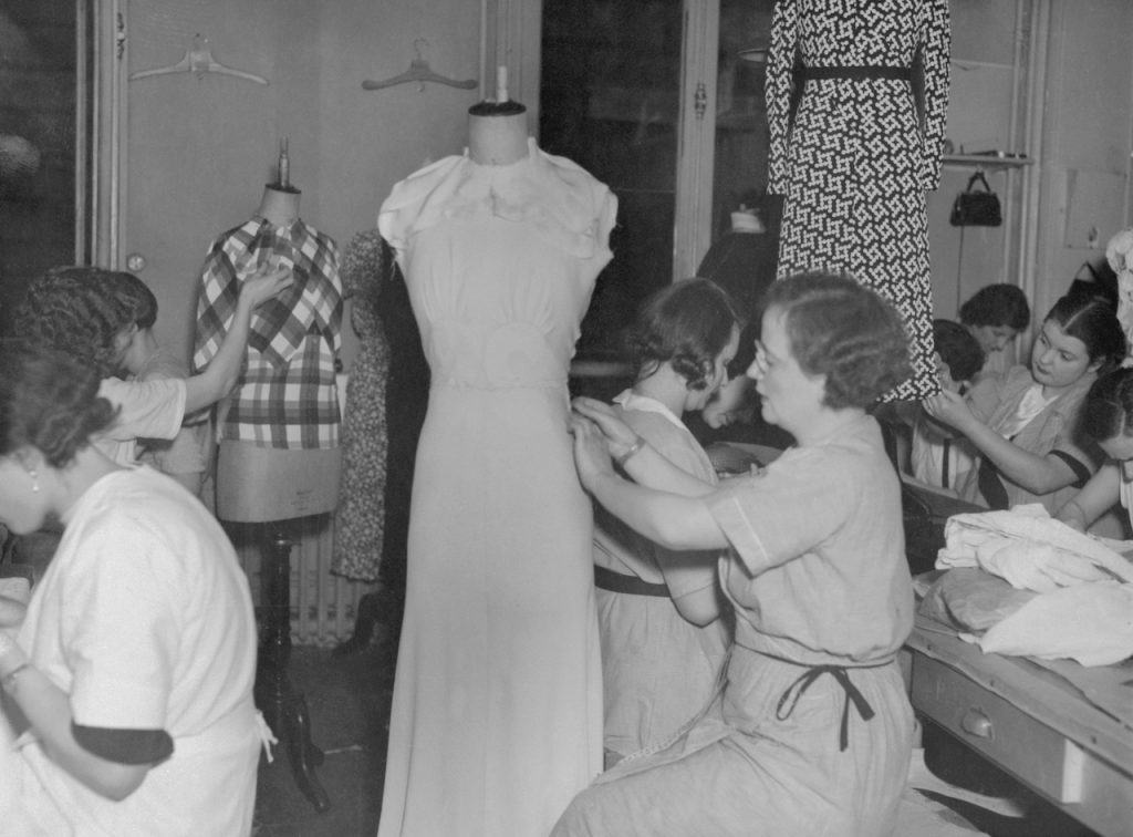 The workshops of Mainbocher, famous Paris couturier, where you see seamstresses at work preparing the trousseau of the American beauty who will wed the Duke of Windsor at Monts on June 3. Bettmann/Bettmann Nast Collection/Getty Images.