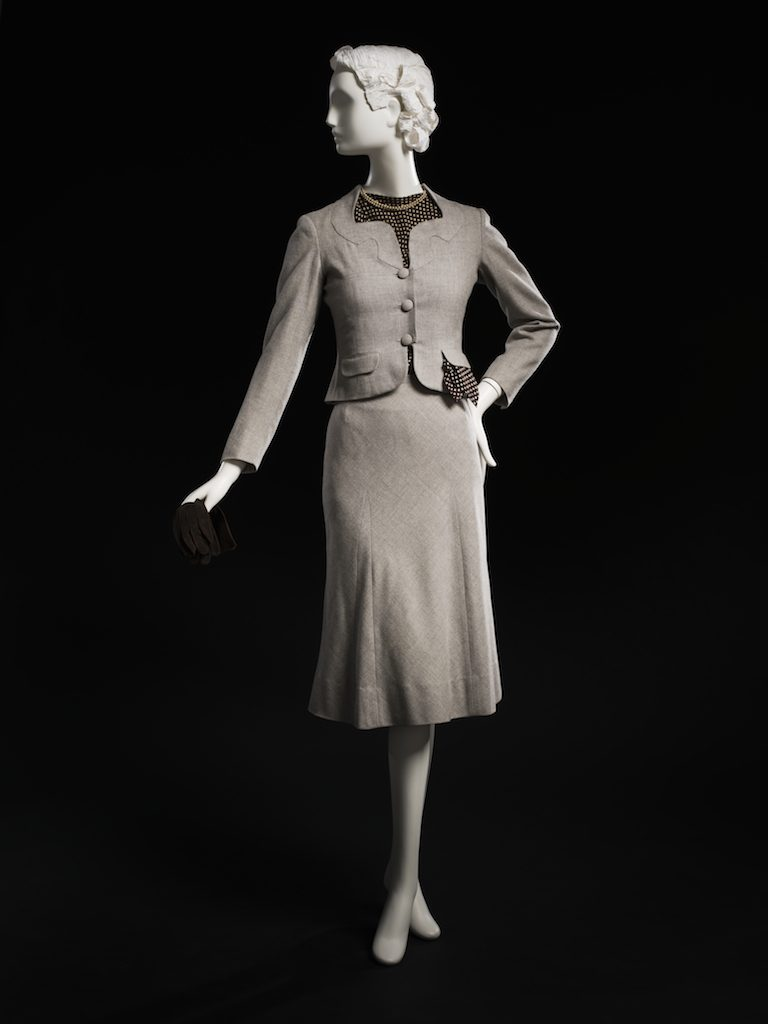 Gray skirt suit with polka dot blouse; skirt suit, spring 1937. This suit is identical to one worn by the Duchess of Windsor. Gift of Mrs. Stephen L. Ingersoll; 1983.622.4.