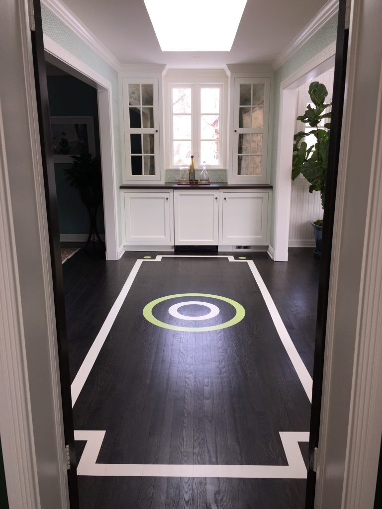 A dark floor catches the eye with a pop of color and visual interest.
