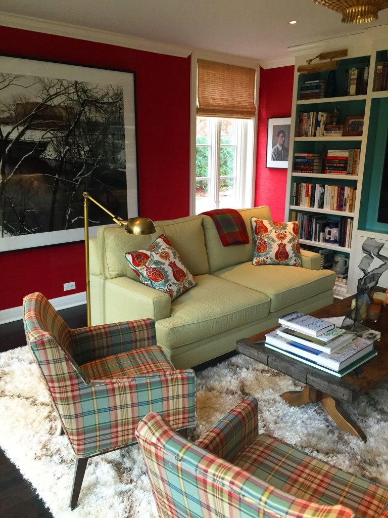 The library at Maple Court, successfully mixing prints and red and green tones.