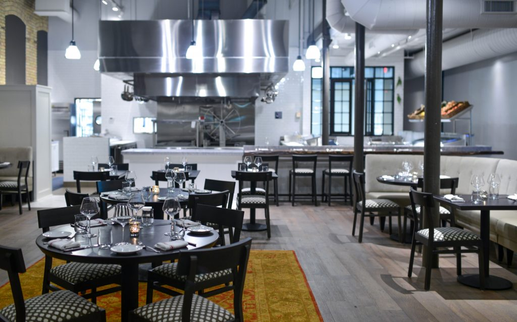 Spoon and Stable's dining room is sleek, but not without warm touches.