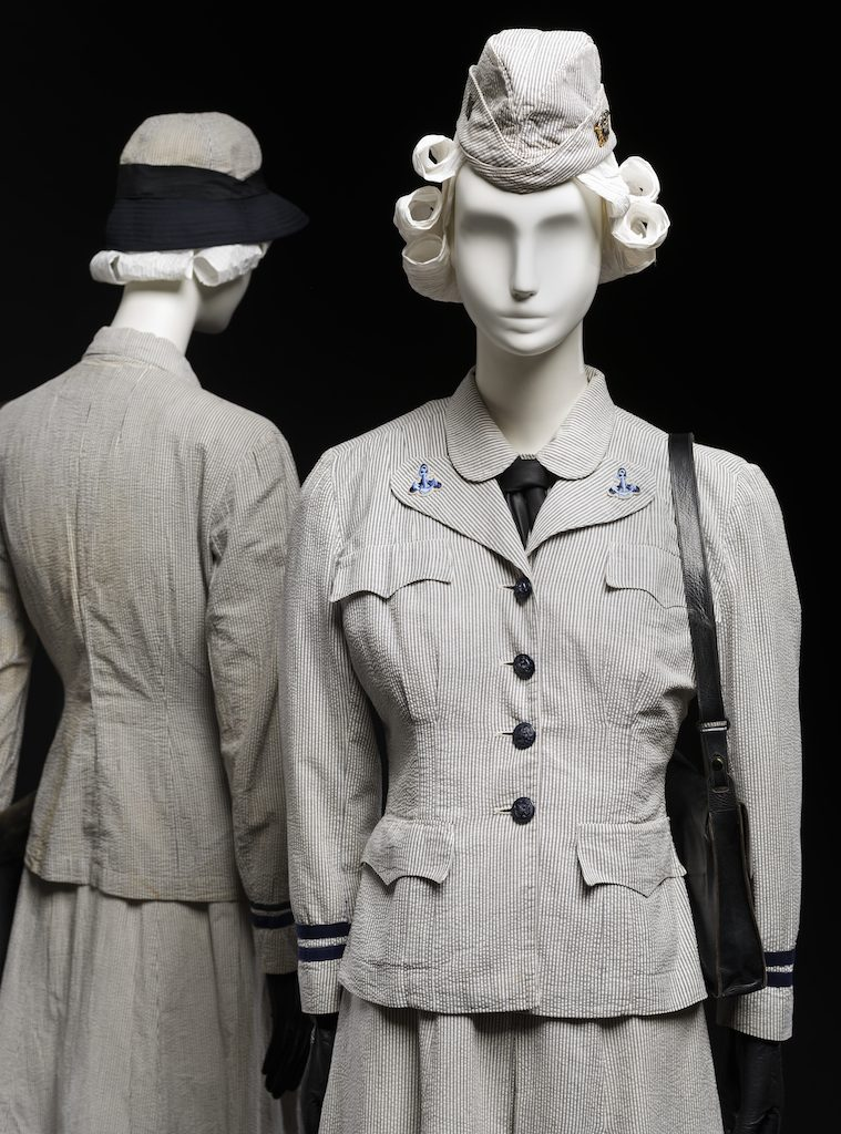 Two Seersucker uniforms; WAVES uniform for summer use, United States Naval Reserve, c. 1942. Gift of Mrs. Myron Ratcliffe; 1992.219; Gift of Mrs. Margaret Heing Ambramson, 1987.67.