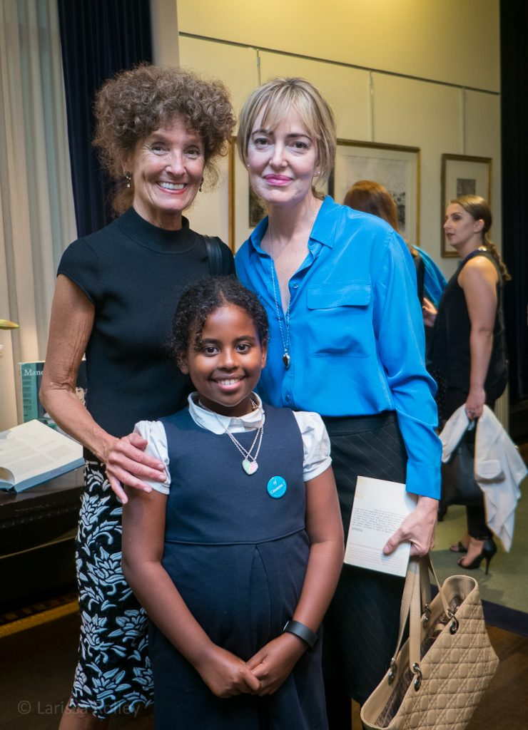 Gloria Groom with Laurie Pasquier and her daughter.
