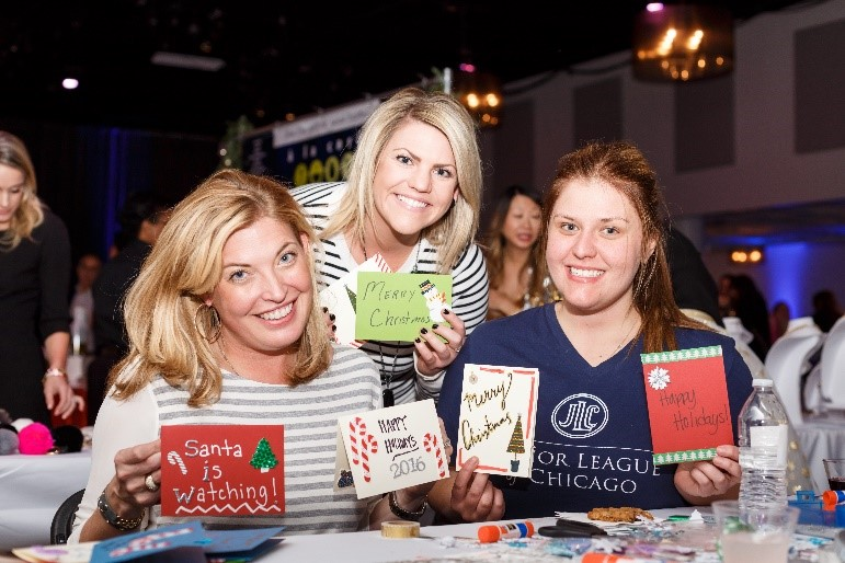 Erika Kennedy and Emily Hunter (at left and center) decorate holiday cards with a friend for at-risk women and children through the JLC's Done in a Day community project.