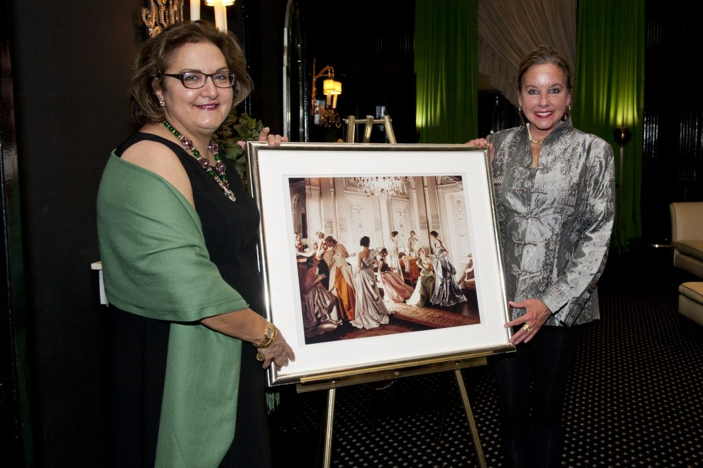 "Pauline Sheehan and Robin McCown with the Beaton photo ""Charles James Dresses."""