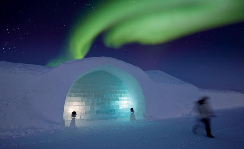 Spend the night in a snow hotel: a private igloo with a glass ceiling for viewing the night sky.
