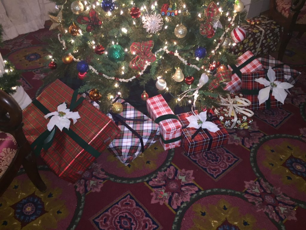 Tartan presents under the tree.