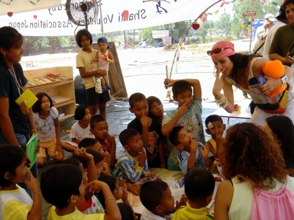 Gloria at a shelter in Thailand working with orphaned children.