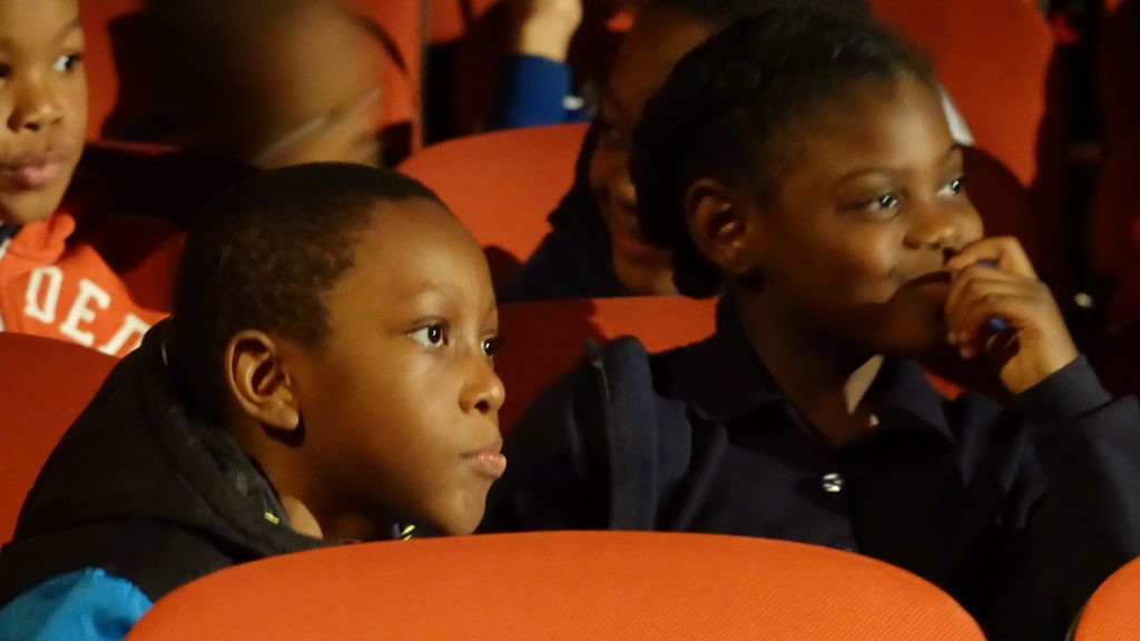 Some audience members enjoying a film at the Children's Festival.