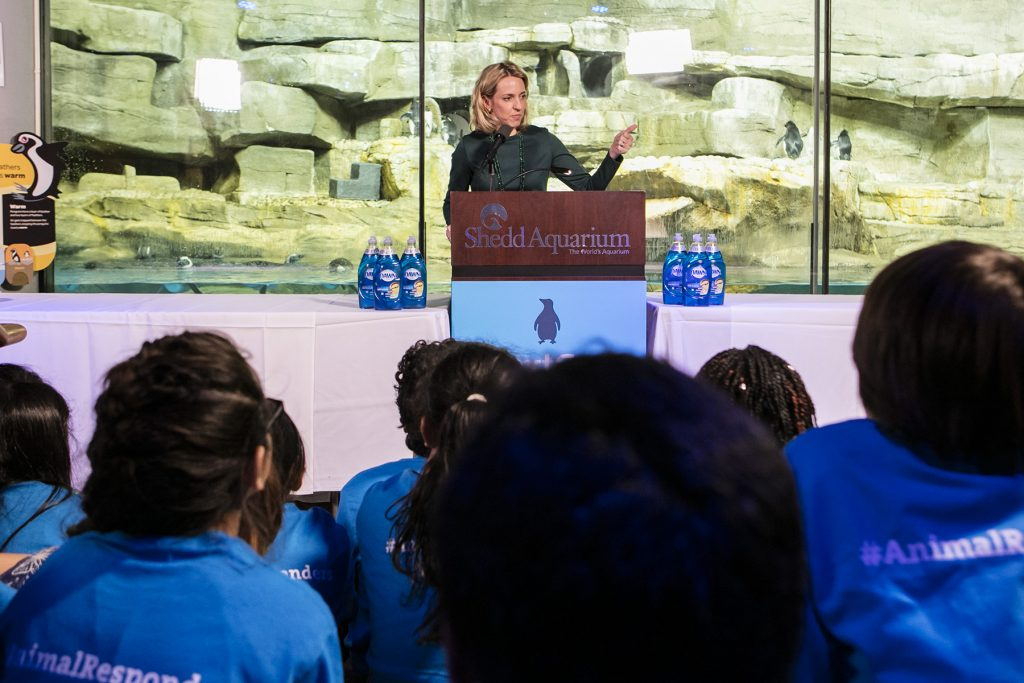 Dr. Bridget C. Coughlin, President and CEO at Shedd Aquarium, welcomes students and attendees to the event, highlighting the importance of the new partnership with Dawn and the launch of a national in-classroom and web accessible curriculum called NextGen Animal Responders.