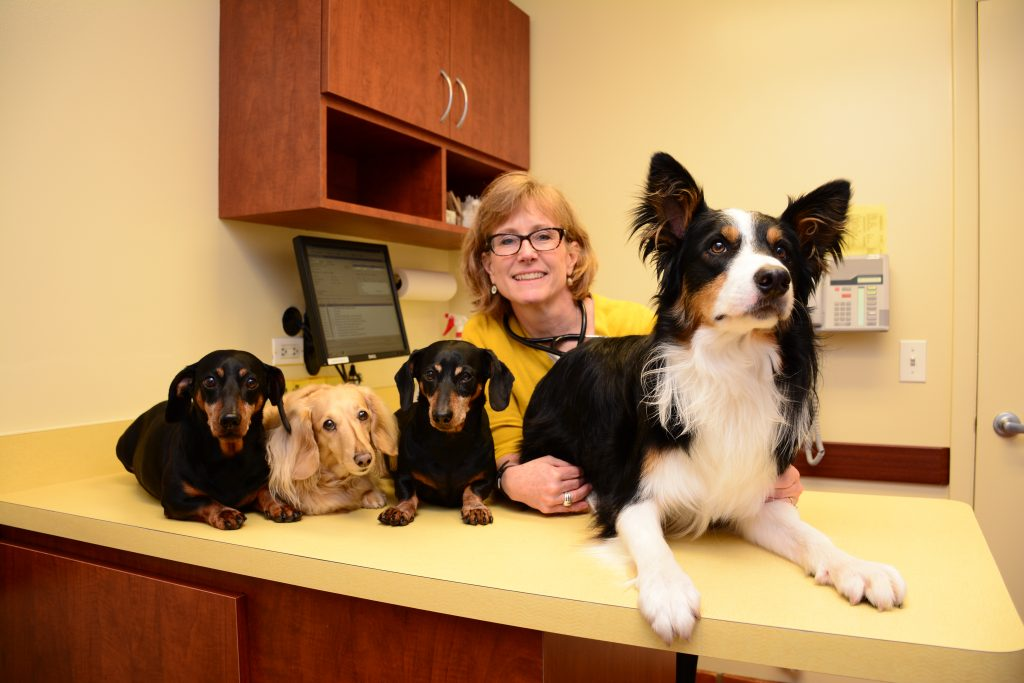 Doctor Jane with patients Jack, Sampson, Tommie, and Gina Marie.