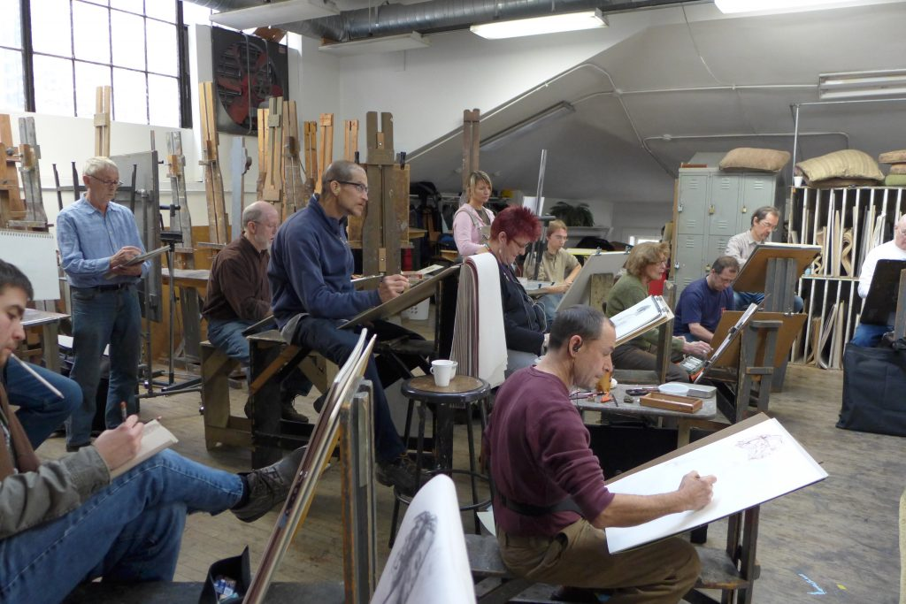 The artists at work. Photo by Del Hall.
