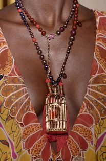 Model on the catwalk, necklace detail