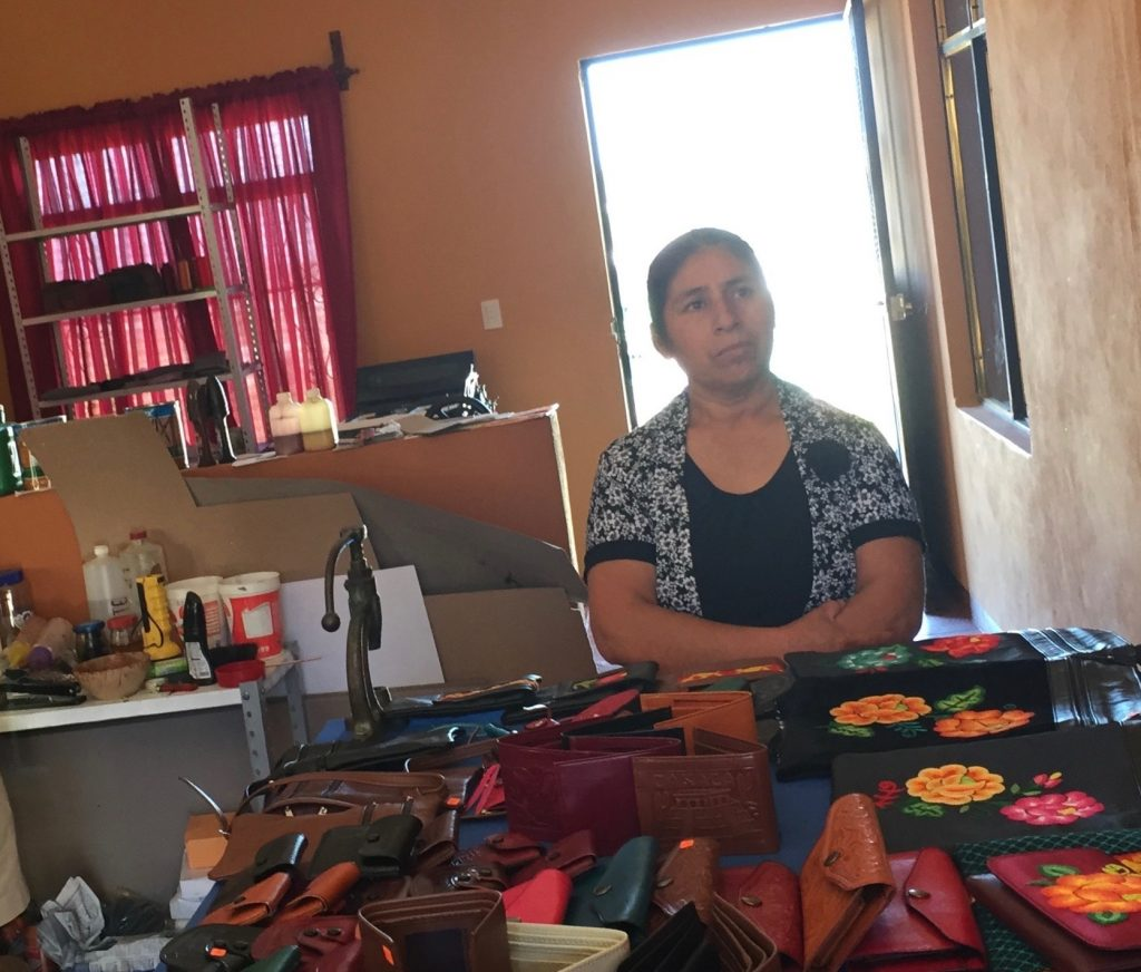 Handmade leather goods for purchase in Lucia's living room.