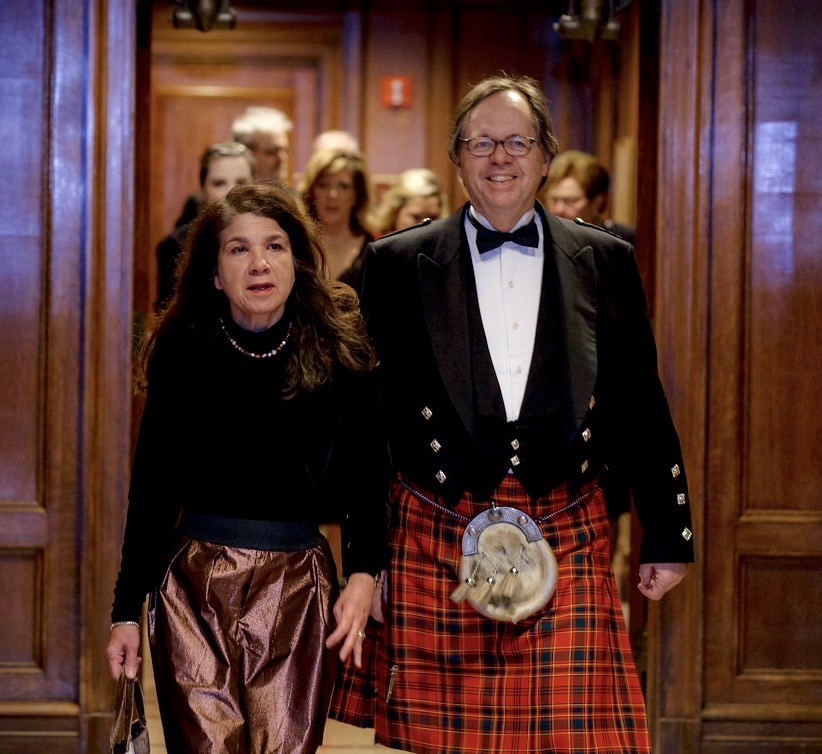Renee and Steve Munro follow the bagpipes to dinner.