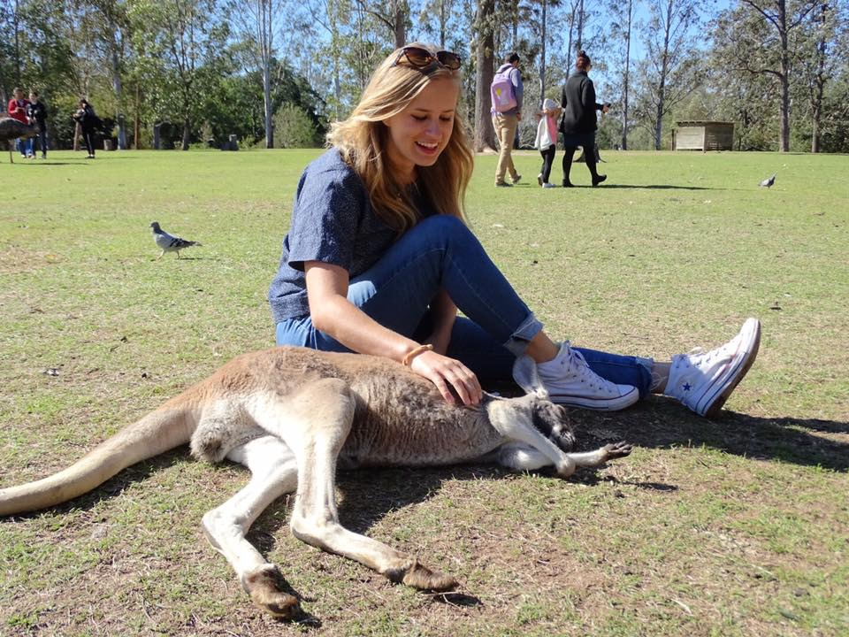 The adventurous Sophia, captured on another of her many travels, enjoying the company of a kangaroo in Australia.