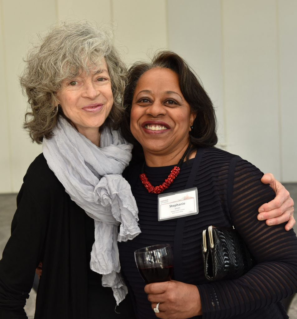Steppenwolf ensemble member Martha Lavey with Steppenwolf Trustee and 2017 Host Committee member Stephanie B. Smith. Photo by Michael Courier.